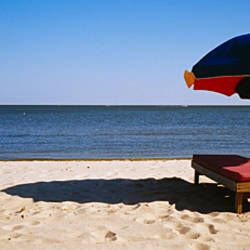 Two beach beds under an umbrella on the beach, Biloxi, Mississippi, USA