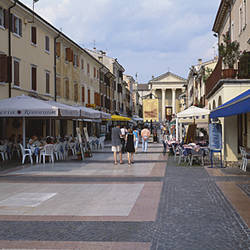 Cafes on both sides of a street, Malcesine, Lake Garda, Italy