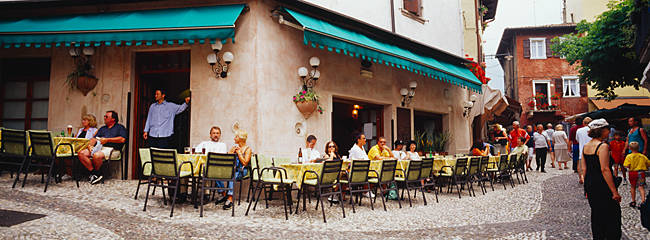 Tourists sitting at a sidewalk cafe, Malcesine, Italy