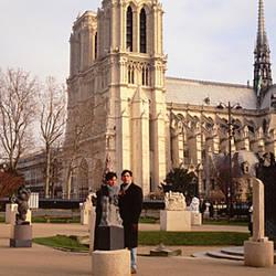 Tourists at a cathedral, Notre Dame, Paris, France
