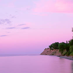 USA, New York, Sodus Bay, Chimney Bluffs State Park, Lake Ontario, Sunset over a lake