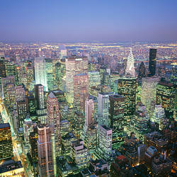 Buildings lit up in a city a night, Manhattan, New York City, New York, USA
