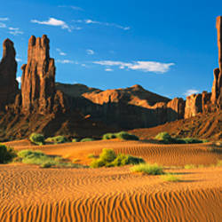Rock formations on a landscape, Totem Pole Rock, Yei Bi Chei, Monument Valley Tribal Park, Arizona, USA