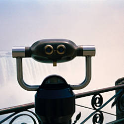 Close-up of coin-operated binoculars facing waterfalls, Niagara Falls, Ontario, Canada
