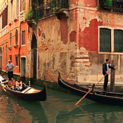 Tourists in a gondola, Venice, Italy