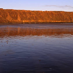 Reflection Of A Hill In Water, Filey Brigg, Scarborough, England, United Kingdom