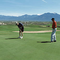 Three Men Playing Golf At A Golf Course, Taos, New Mexico, USA