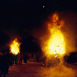 Group of people walking near a bonfire, Taos, New Mexico, USA