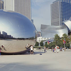 Group of people in a park, Cloud Gate, Millennium Park, Chicago, Illinois, USA