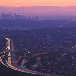 Aerial view of a city at dusk looking towards Los Angeles, Glendale, California, USA