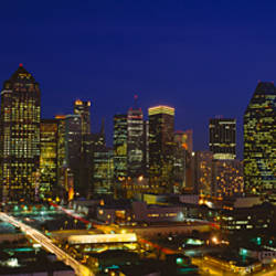 Buildings in a city lit up at night, Dallas, Texas, USA