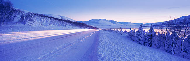 Highway running through a snow covered landscape, Akureyri, Iceland