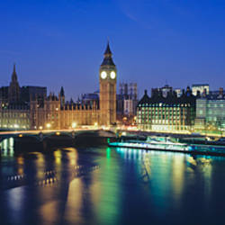 Buildings lit up at dusk, Big Ben, Houses Of Parliament, Thames River, London, England