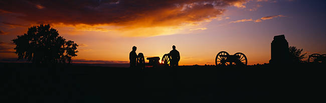Silhouette of statues of soldiers and cannons in a field, Gettysburg National Military Park, Pennsylvania, USA