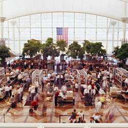 High angle view of passengers at a concourse of an airport, Denver International Airport, Denver, Colorado, USA