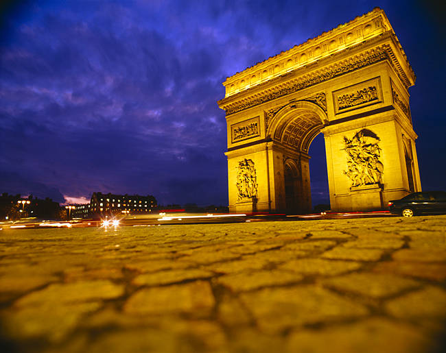 Low angle view of a triumphal arch, Arc De Triomphe, Paris, France