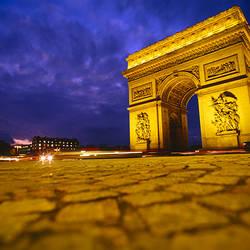 Low angle view of a triumphal arch, Arc De Triomphe, Paris, France