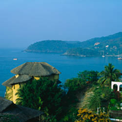 High angle view of huts on a hilltop, Zihuatanejo, Guerrero, Mexico