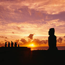 Silhouette of Moai statues at dusk, Tahai Archaeological Site, Rano Raraku, Easter Island, Chile