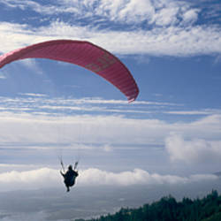 Silhouette of a person paragliding, Marin County, California, USA