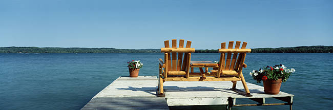 USA, Minnesota, rear view of two Adirondack chairs on a dock