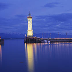 Germany, Lindau, Reflection of Lighthouse in the lake Constance