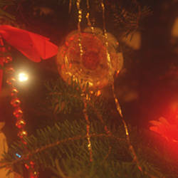 Close-up of Christmas decorations lit up at night