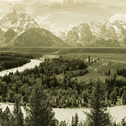 River flowing through a landscape with mountains in the background, Snake River, Grand Teton National Park, Wyoming, USA