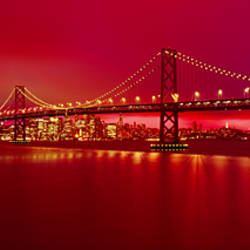 Suspension bridge lit up at night, Bay Bridge, San Francisco, California, USA