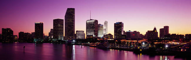 Buildings lit up at dusk, Biscayne Bay, Miami, Miami-Dade county, Florida, USA