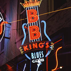 Low angle view of neon signs lit up at night, Beale Street, Memphis, Tennessee, USA