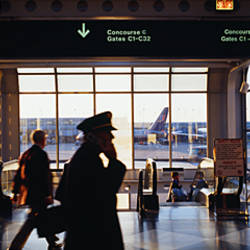Group of people in an airport terminal, O'Hare Airport, Chicago, Illinois, USA