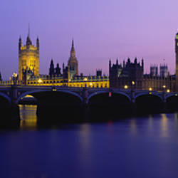 Buildings lit up at dusk, Big Ben, Houses of Parliament, London, England