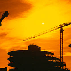 Silhouette of cranes at a construction site, London, England