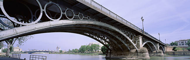 Low Angle View Of Isabel II Bridge Over Guadalquivir River, Seville, Spain
