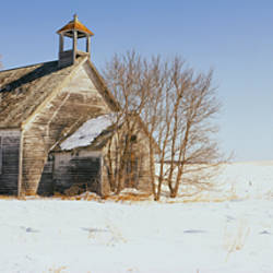 Abandoned schoolhouse on a snow-covered landscape, Friberg Township, Minnesota, USA