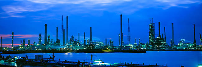 Factory lit up at dusk, Antwerp, Belgium