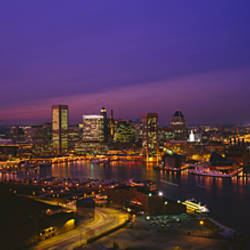 Aerial view of a city lit up at dusk, Baltimore, Maryland, USA