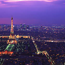 Aerial view of a city at twilight, Eiffel Tower, Paris, Ile-de-France, France