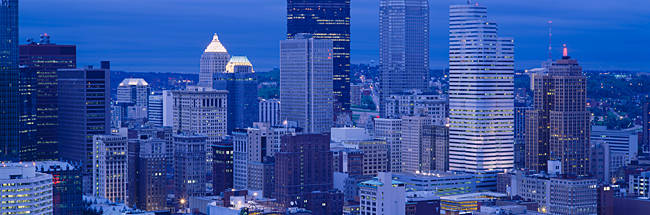 Buildings in a city lit up at dusk, Pittsburgh, Pennsylvania, USA