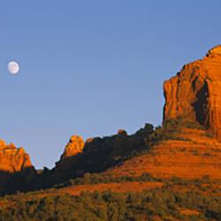 Low angle view of Moon over red rocks, Sedona, Arizona, USA