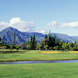 Golf course in front of mountains, Princeville, Kauai, Hawaii, USA