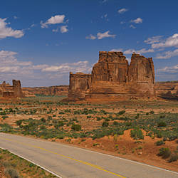Empty road running through a national park, Arches National Park, Utah, USA