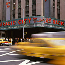Cars in front of a building, Radio City Music Hall, New York City, New York State, USA