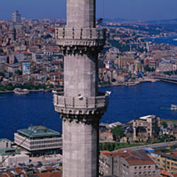 Mid section view of a minaret with bridge across the bosphorus in the background, Istanbul, Turkey