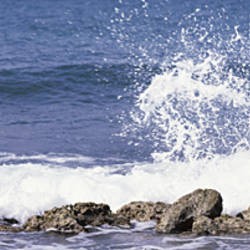 Puerto Rico, Vieques, Water splashing with rocks on the beach