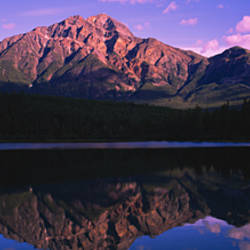 Reflection of mountains in a lake, Pyramid Lake, Jasper National Park, Alberta, Canada