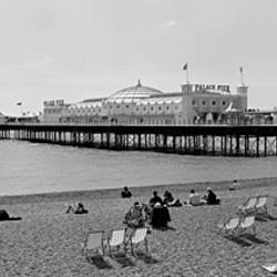 Tourists on the beach, Brighton, England