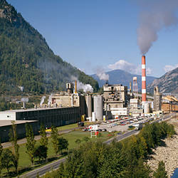 Steam emerging from smoke stacks of a factory, Celgar Pulp Company, Castlegar, British Columbia, Canada