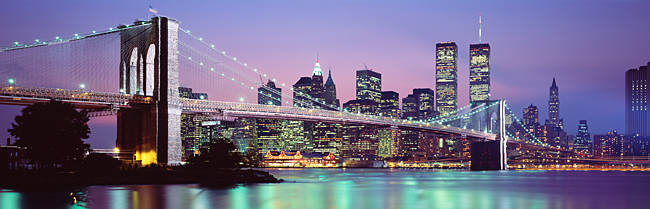 Bridge across a river lit up at dusk, Brooklyn Bridge, East River, World Trade Center, Wall Street, Manhattan, New York City, New York State, USA